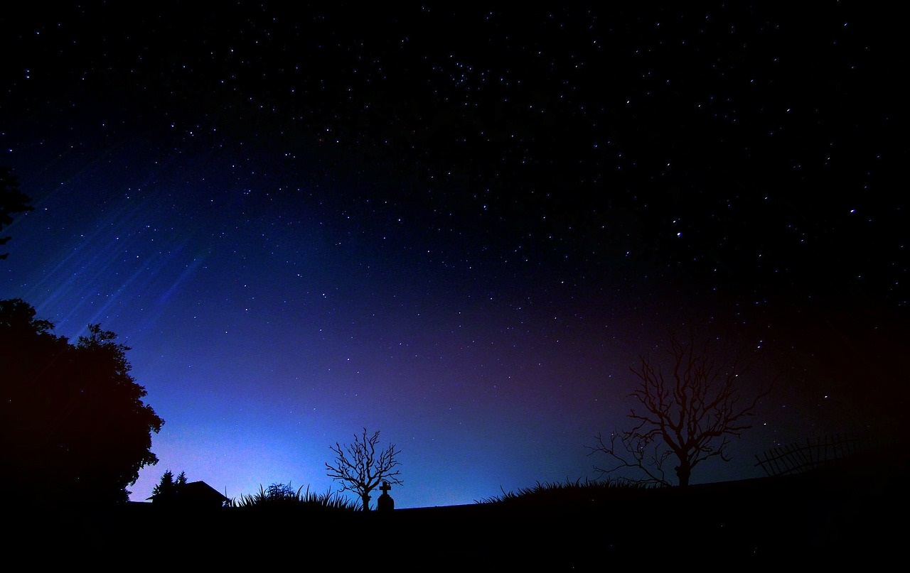 Nightscape of house and starry skies
