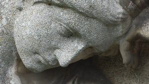 Sculpture sad woman's face