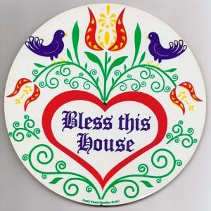 Circle sign that says Bless this House, with Amish design birds and flowers